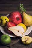 Fresh fruits on the plate Royalty Free Stock Photo
