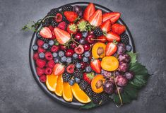 Fresh fruits plate. royalty free stock photography