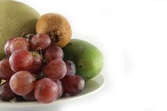 Fresh Fruits & plate left image Stock Photography