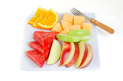 Fresh fruits in plate on white background Stock Photos