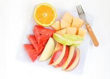 Fresh fruits in plate on white background Stock Photo