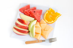 Fresh fruits in plate on white background Royalty Free Stock Photo