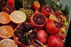 Fresh fruits. Pomegranates, oranges, pineapples, apples are selling at the Turkish market Stock Photos