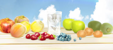 Fresh fruits and pure water. Mixed fruits background.Healthy eat Royalty Free Stock Images