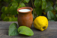 Fresh fruits,  quince and milk Royalty Free Stock Photos