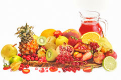 Fresh fruits and red juice. Isolated on white Stock Photography