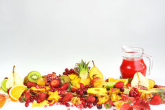 Fresh fruits and red juice Stock Images