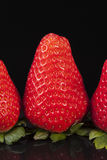 Fresh fruits of red strawberry isolated on black background Royalty Free Stock Images