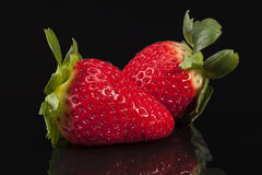 Fresh fruits of red strawberry isolated on black background Stock Images