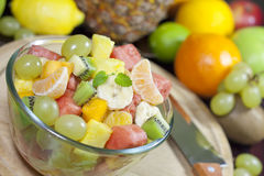 Fresh fruits salad in bowl in kitchen Royalty Free Stock Photography
