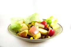 Fresh fruits salad in dish isolated Royalty Free Stock Photos
