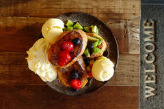 Fresh fruits salad with ice cream on plate and berries with grilled chicken Stock Photography