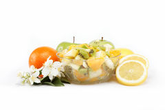 Fresh fruits and salad isolated on a white. Stock Image