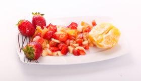 Fresh fruits salad. On modern dish royalty free stock photo