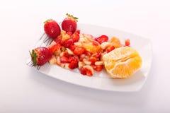 Fresh fruits salad. On modern dish stock photography