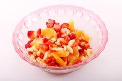 Fresh fruits salad. On modern dish stock image