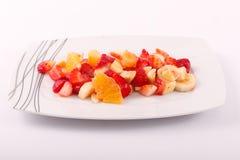 Fresh fruits salad. On modern dish royalty free stock photography