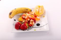 Fresh fruits salad. On modern dish royalty free stock image