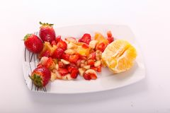 Fresh fruits salad. On modern dish royalty free stock images