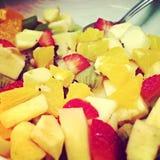Fresh fruits. Salad with strawberries apples kiwi oranges banana Royalty Free Stock Images