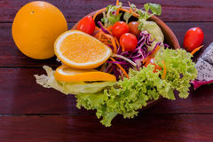 Fresh fruits salad. In wood bowl on the wood table stock image