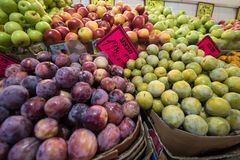 Fresh fruits for sale. Colorful fruits background. Plums and apples royalty free stock photography