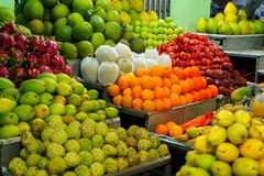 Fresh fruits for sale. At night market in Vietnam. Exotic tropical food royalty free stock image