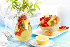 Fresh fruits served in melon bowl Stock Images