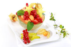 Fresh fruits served in melon bowl Stock Image