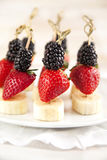 Fresh fruits on the skewers. Shallow depth of field Royalty Free Stock Image