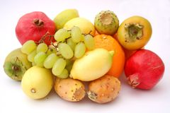 Fresh fruits. Some figs, pomegranates, grapes and lemons Royalty Free Stock Photos