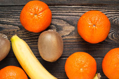 Fresh fruits. Some mandarins, kiwi and bananas on wooden tabble Stock Photography