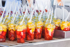 Fresh fruits sorted in plastic cups with forks Royalty Free Stock Photography