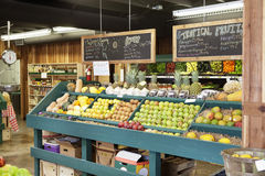 Fresh fruits stall with text on blackboard in supermarket Royalty Free Stock Photography