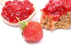 Fresh fruits and strawberry jam on white background Stock Image