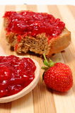 Fresh fruits and strawberry jam on wooden cutting board Royalty Free Stock Photo