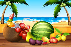 Fresh fruits on the table by the beach Stock Photography