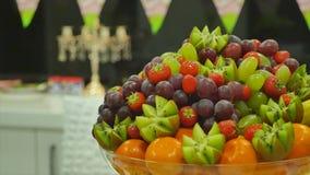 Fresh fruits on table celebrating stock footage