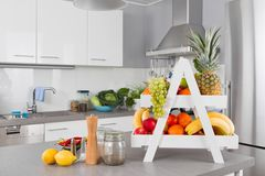 Fresh fruits on table in the kitchen Royalty Free Stock Images