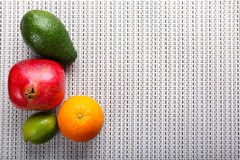 Fresh fruits on tablecloth background Royalty Free Stock Photography