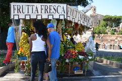 Fresh Fruits to sell. Couple buying fruits in the street of Romw Stock Image