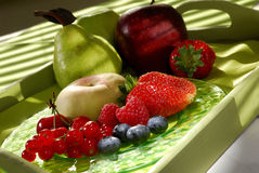 Fresh fruits on a tray. Fresh fruits on a plate and on a tray Royalty Free Stock Photos