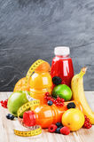 Fresh fruits and various juices Royalty Free Stock Images