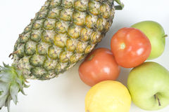 Fresh fruits and vegetables. Fresh produce including pineapple, tomatoes, apples and lemon Stock Photography