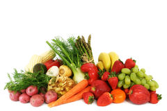 Fresh fruits and vegetables. A pile of fresh, healthy fruits and vegetables isolated on white Stock Photography