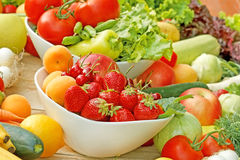 Fresh fruits and vegetables. In a bowl stock images