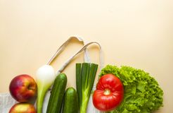 Fresh fruits and vegetables in cotton bag royalty free stock image