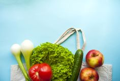 Fresh fruits and vegetables in cotton bag stock photo
