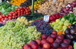 Fresh fruits and vegetables in farmer`s market. Fresh ripe juicy fruits and vegetables in a local farmer`s market, Croatia stock images