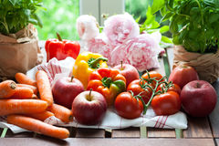 Fresh fruits, vegetables and flowers. Cooking backstage stock images